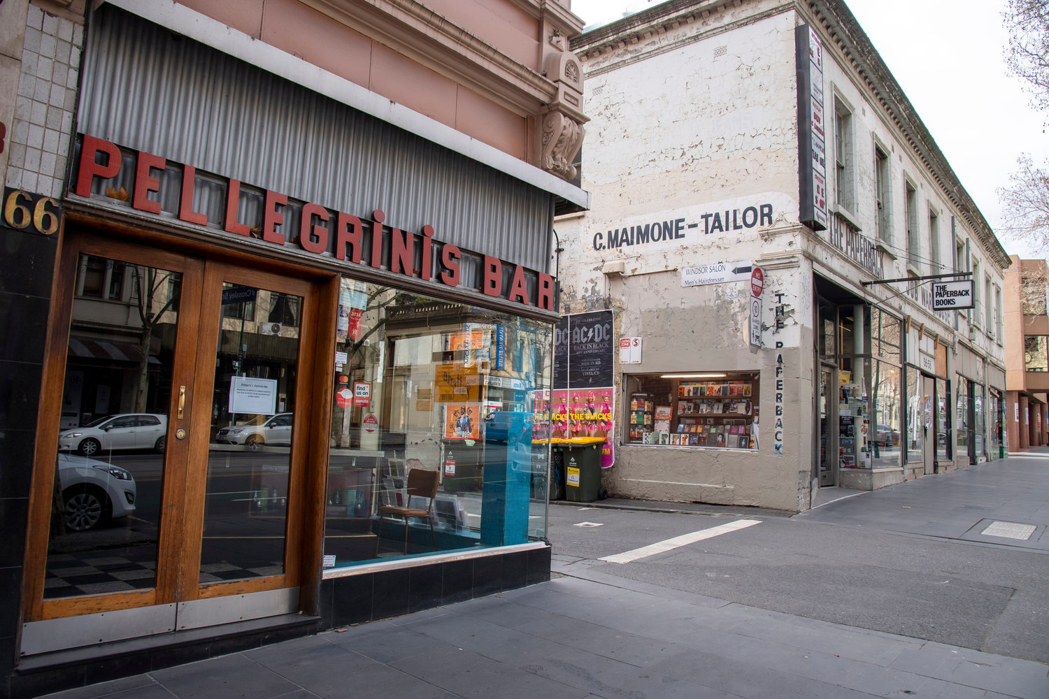 Pellegrinis Cafe and The Paperback book store closed during lockdown due to the continuing spread of the coronavirus in Melbourne, Thursday, Aug. 6, 2020. Victoria state, Australia's coronavirus hot spot, announced on Monday that businesses will be closed and scaled down in a bid to curb the spread of the virus. (AP Photo/Andy Brownbill)