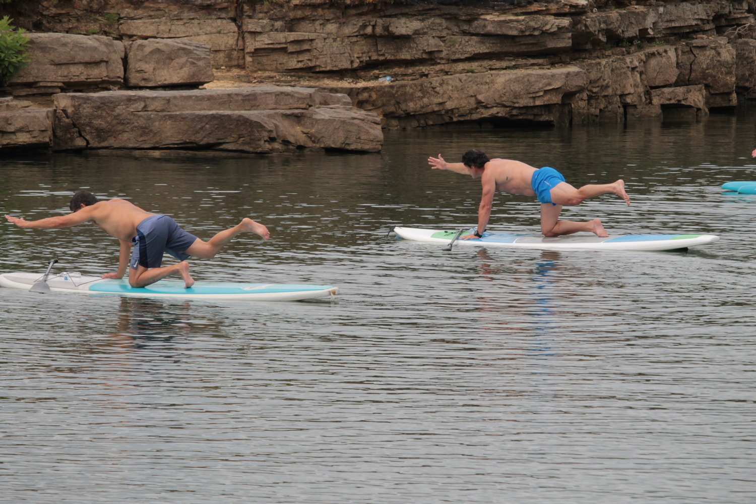 Six students participated in a free paddle board yoga class at Smith Lake Dame on Saturday.