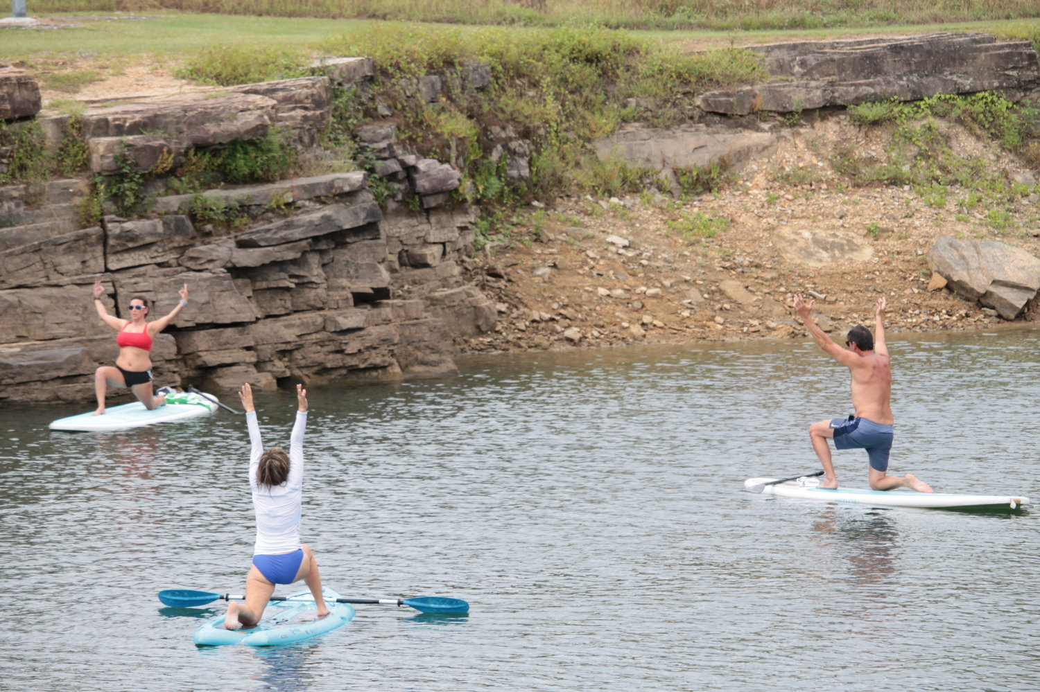 Instructor Jeanna Weygand leads a paddle board yoga class at Smith Lake Dam on Saturday. The class was hosted by Pine Valley Outdoor Living.