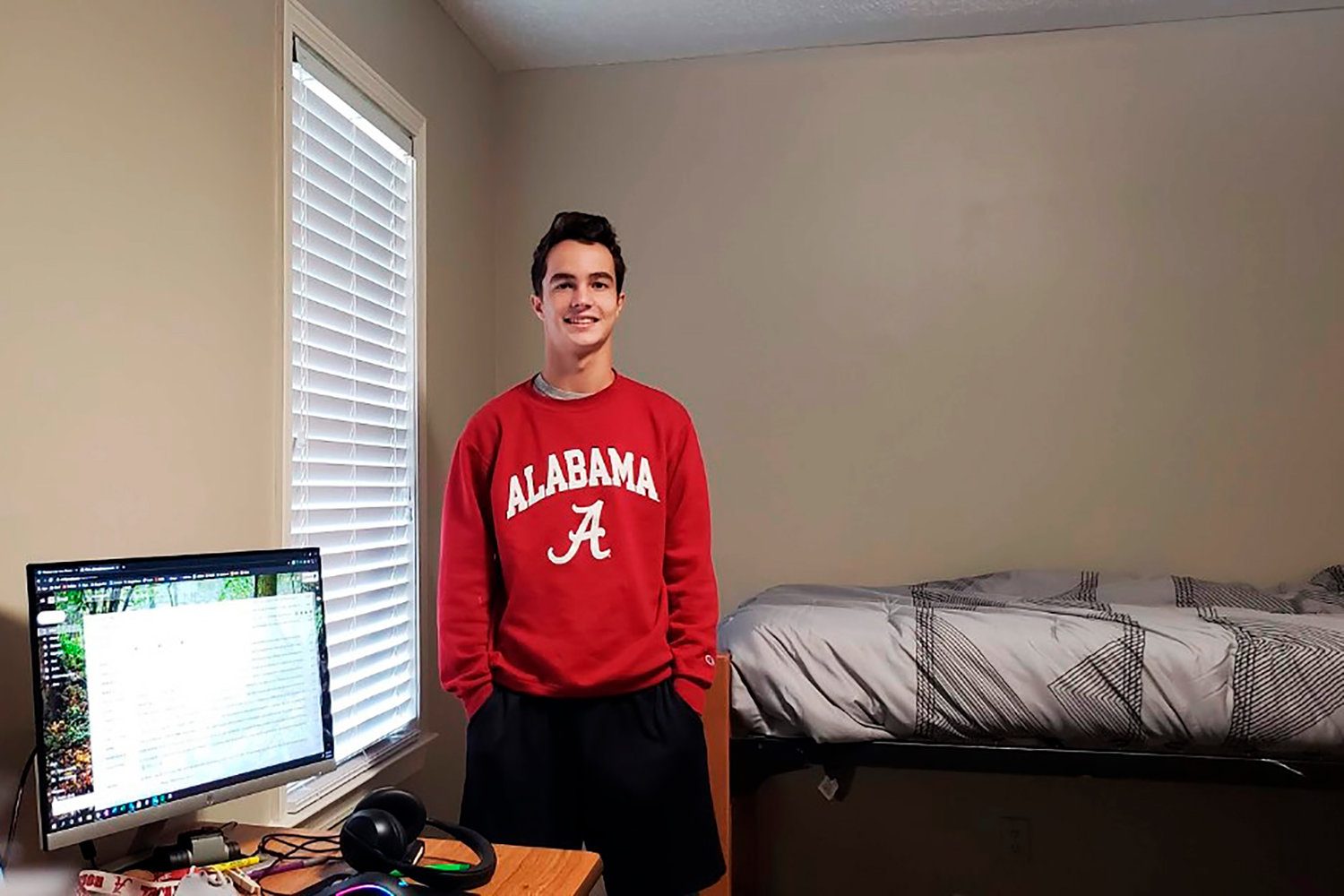 In this Sept. 1, 2020, photo provided by Zachary Bourg, he poses for a photo in an isolation unit at the University of Alabama in Tuscaloosa, Ala. Bourg lived there for 10 days after he tested positive for the virus.  (Zachary Bourg via AP)