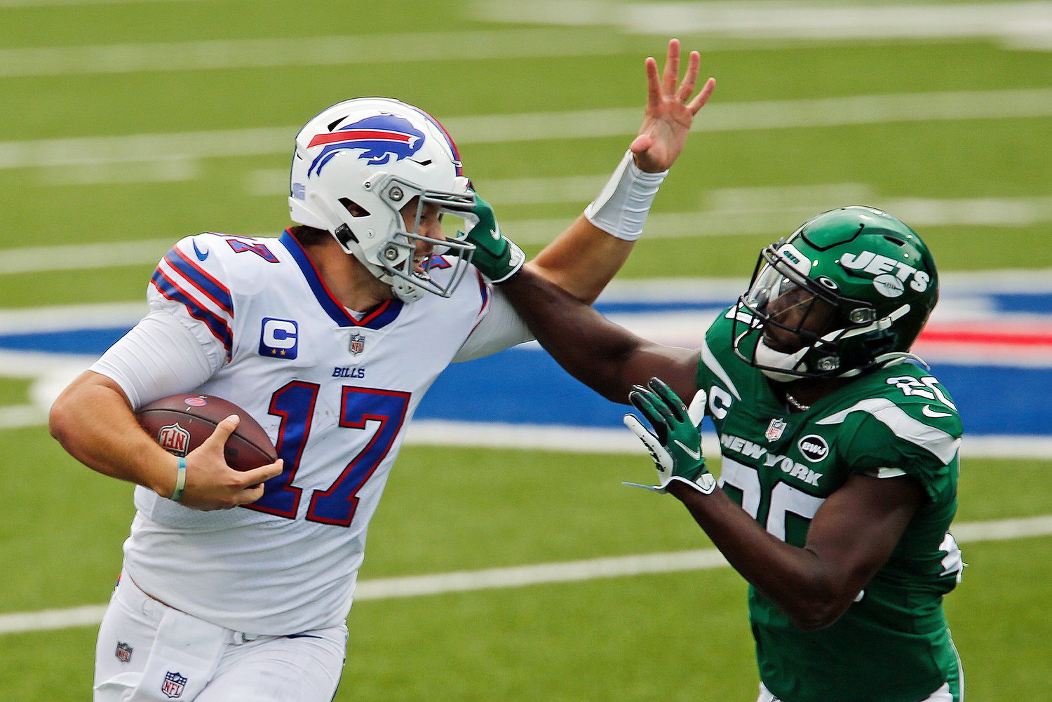 Buffalo Bills quarterback Josh Allen (17) is pushed out of bounds by New York Jets free safety Marcus Maye (20) during the first half of an NFL football game in Orchard Park, N.Y., Sunday, Sept. 13, 2020. (AP Photo/John Munson)