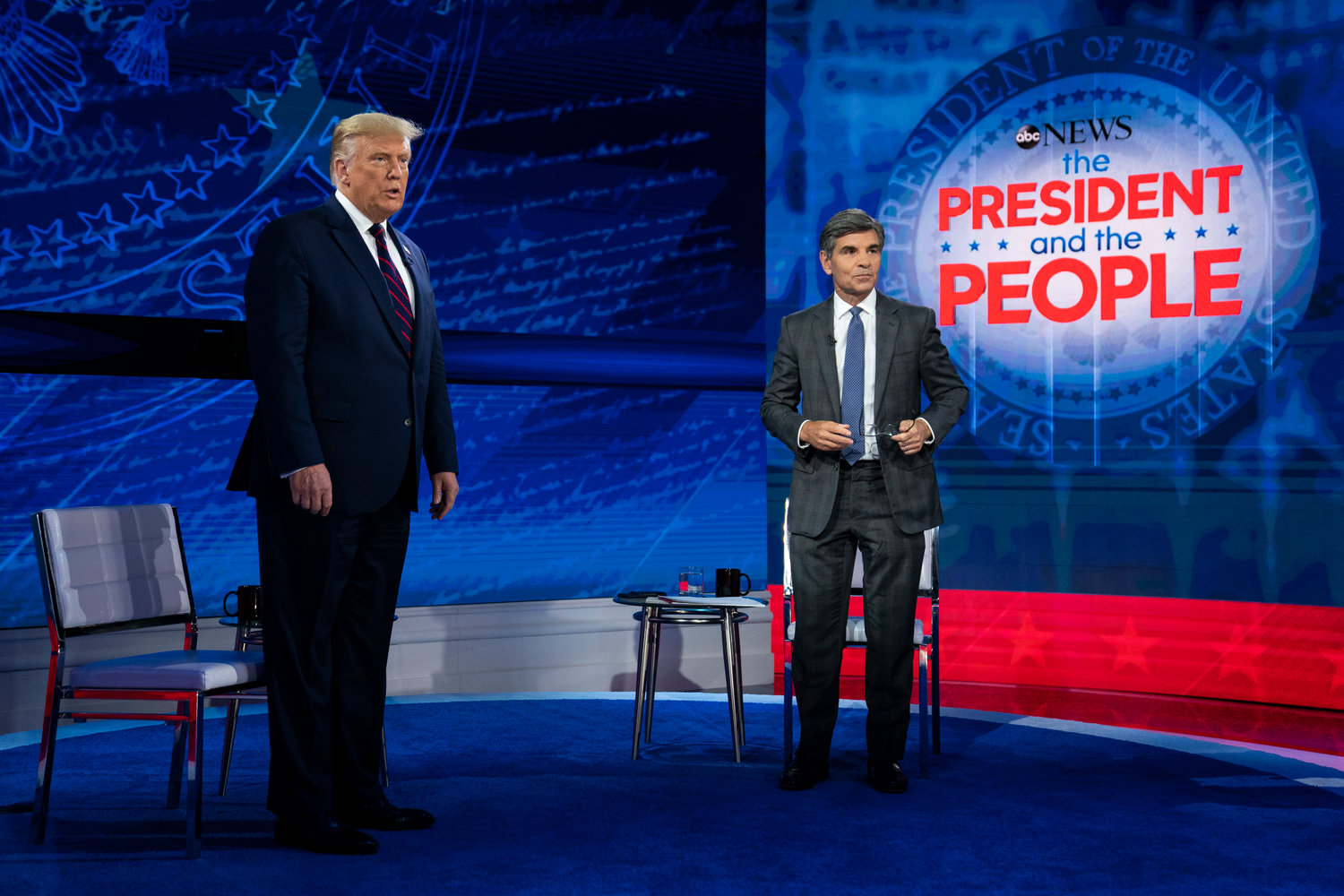 President Donald Trump talks with ABC News anchor George Stephanopoulos before a town hall at National Constitution Center, Tuesday, Sept. 15, 2020, in Philadelphia. (AP Photo/Evan Vucci)
