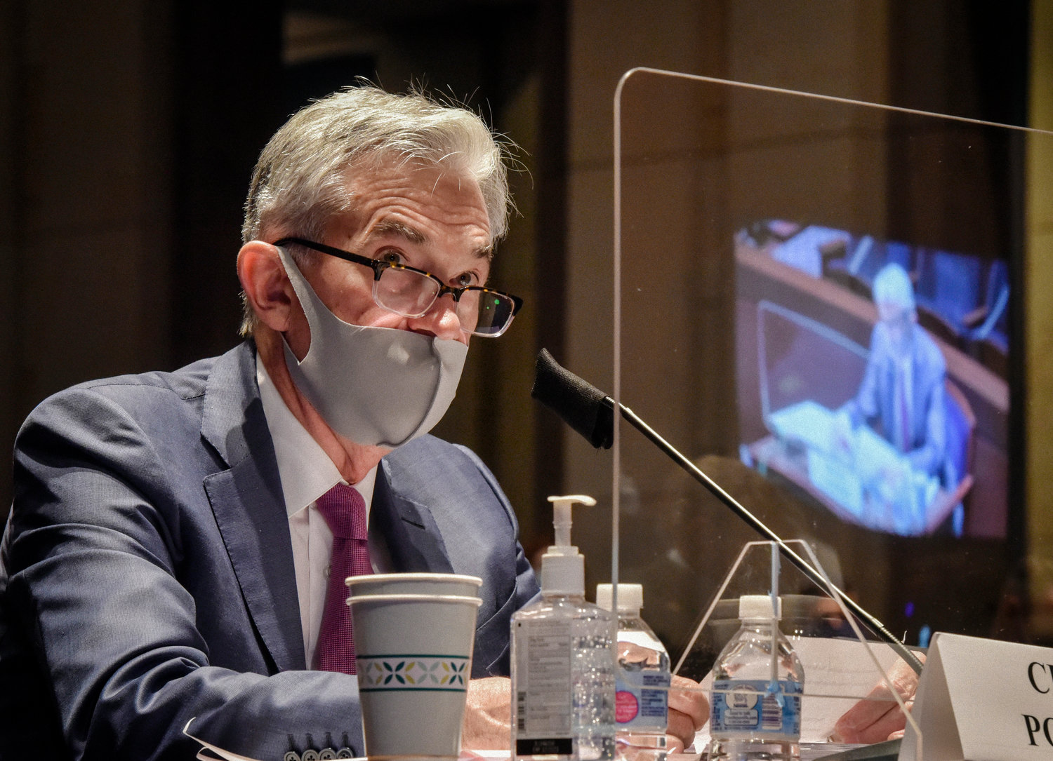 WASHINGTON, DC - June 30: .Fed Chairman Jerome Powell is reflected in the sneeze guard set up between himself and members of the House Committee on Financial Services hearing on Oversight of the Treasury Department and Fed Reserve Pandemic response in Washington, DC on June 30. .(Photo by Bill O'Leary/The Washington Post-POOL)