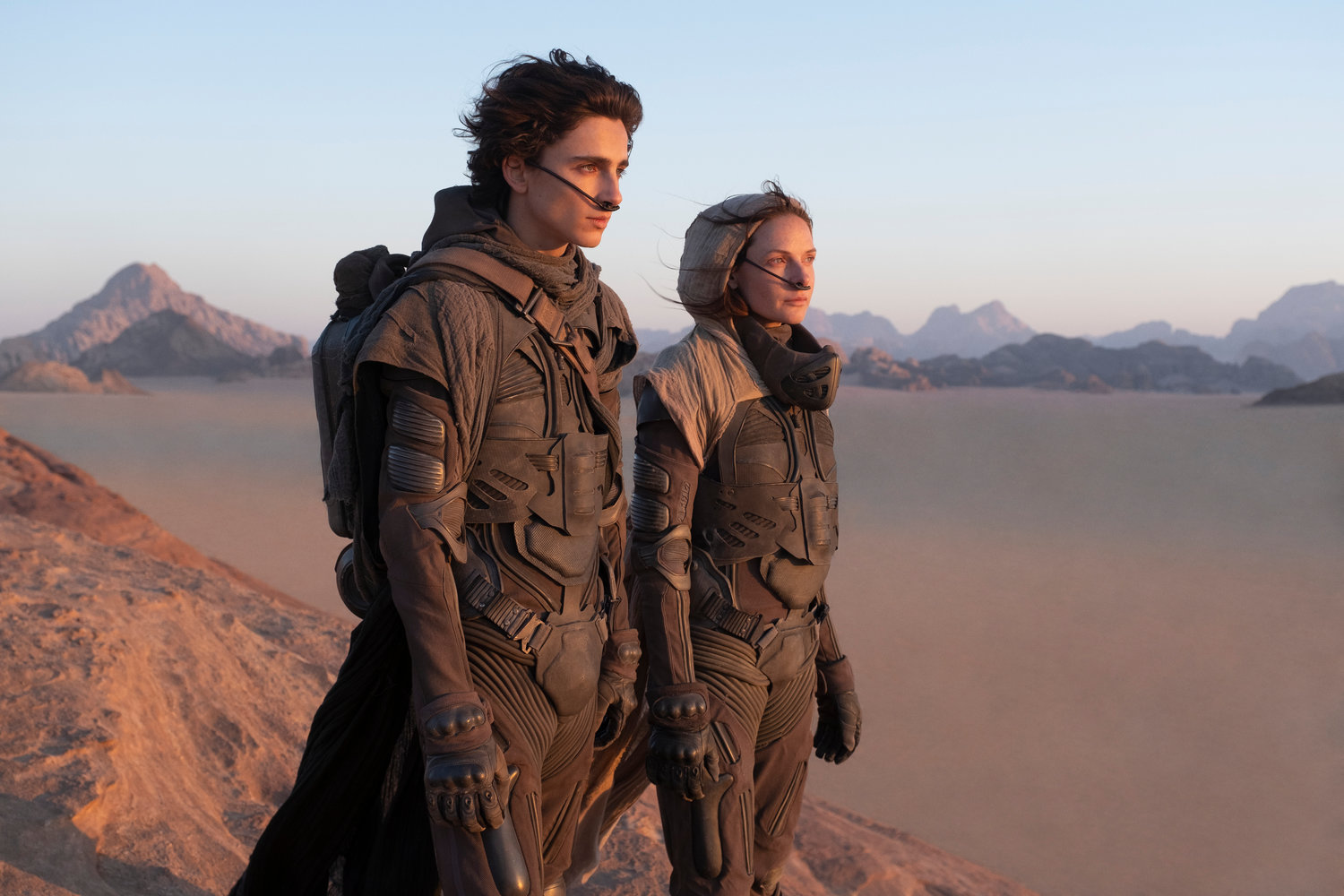 "This image released by Warner Bros. Entertainment shows Timothee Chalamet, left, and Rebecca Ferguson in a scene from ""Dune."" Warner Bros. said late Monday that its sci-fi pic ""Dune"" will now open in October 2021, instead of this December. The studio also pushed back it's ""Matrix"" sequel by 8 months to late 2021 and ""The Batman"" to 2022. (Chia Bella James/Warner Bros. Entertainment via AP)"