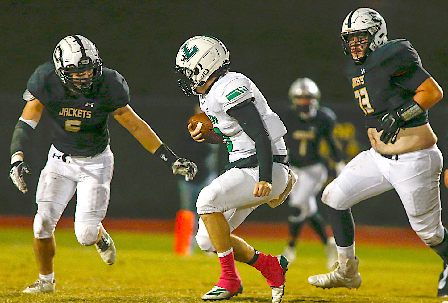 Corner's Joshua Myrick looks to tackle a Leeds player during their game Friday night.