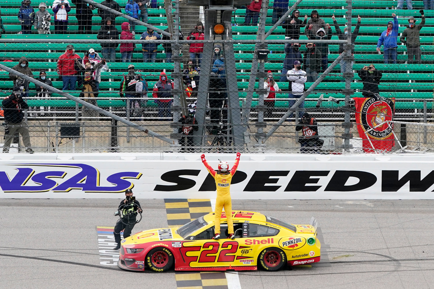 Joey Logano celebrates after winning a NASCAR Cup Series auto race at Kansas Speedway in Kansas City, Kan., Sunday, Oct. 18, 2020. (AP Photo/Orlin Wagner)