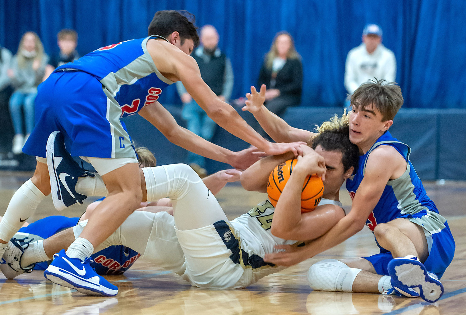 Cordova and Dora players battle for a loose ball during their game on Friday night.