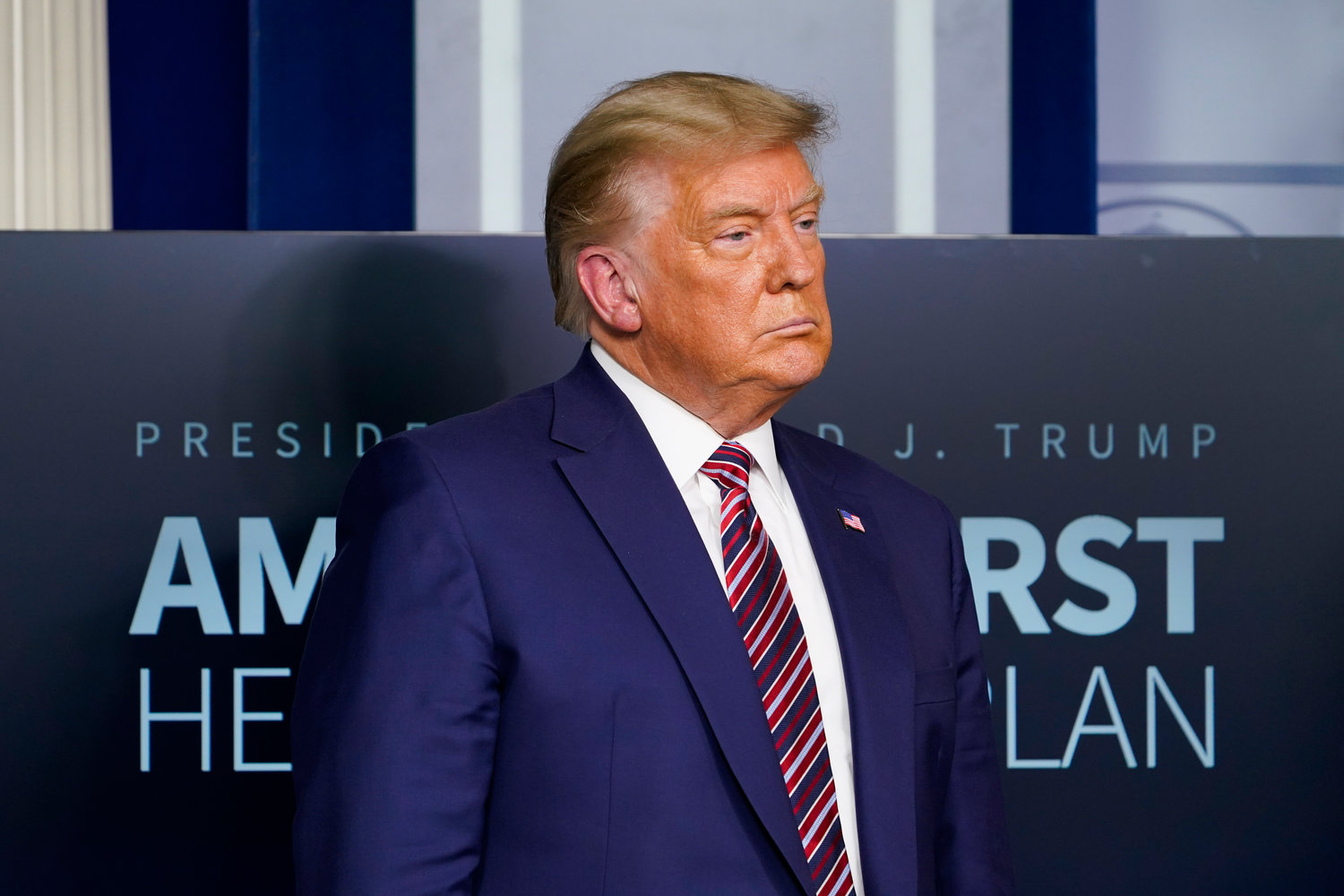 FILE - In this Nov. 20, 2020, file photo President Donald Trump listens during a news conference in the briefing room at the White House in Washington. (AP Photo/Susan Walsh, File)