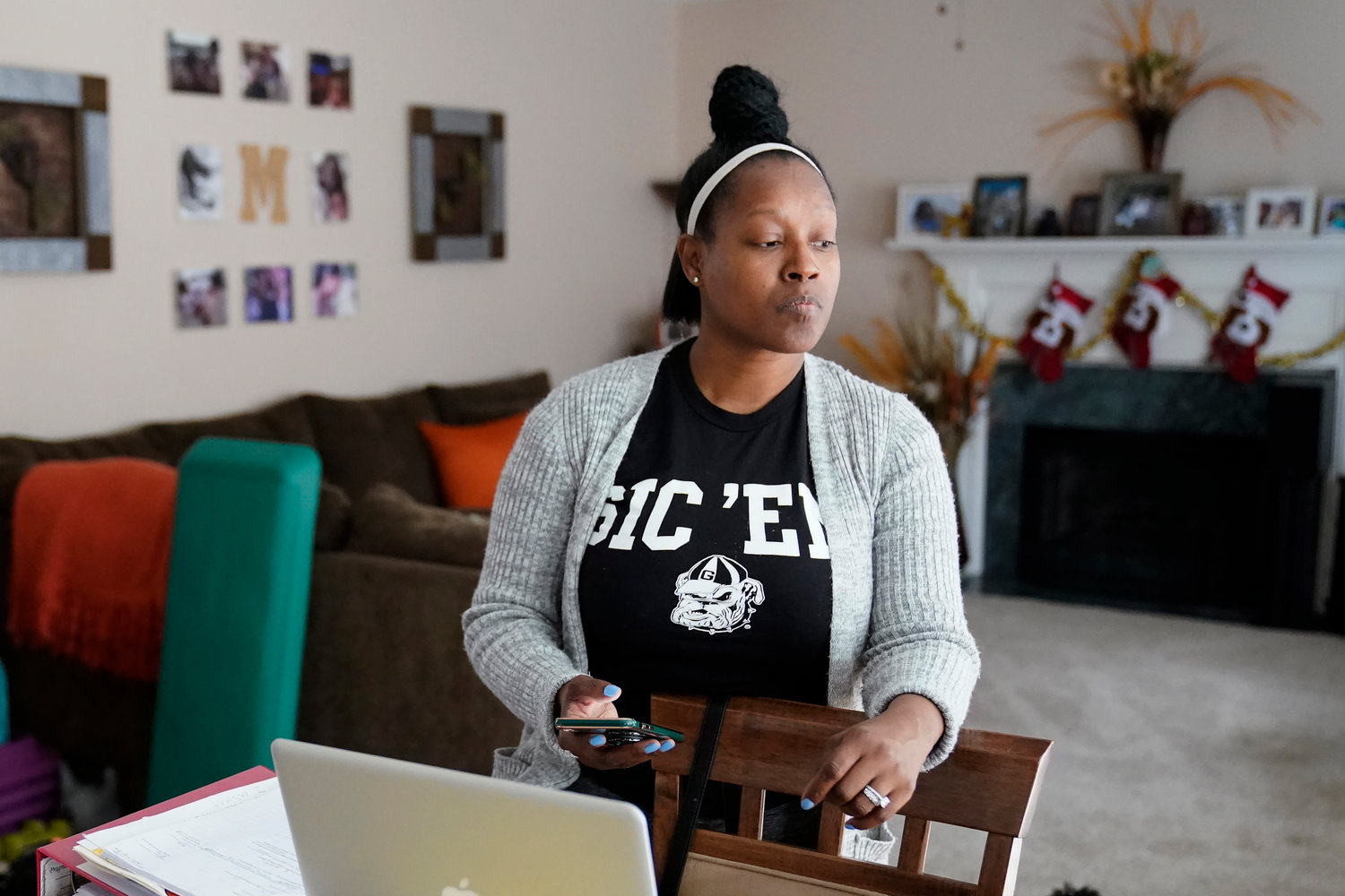Shanita Matthews pauses as she speaks in her home, Wednesday, Dec. 23, 2020, in Suwanee, Ga. Matthews had to close her wedding business because of the coronavirus outbreak. (AP Photo/John Bazemore)