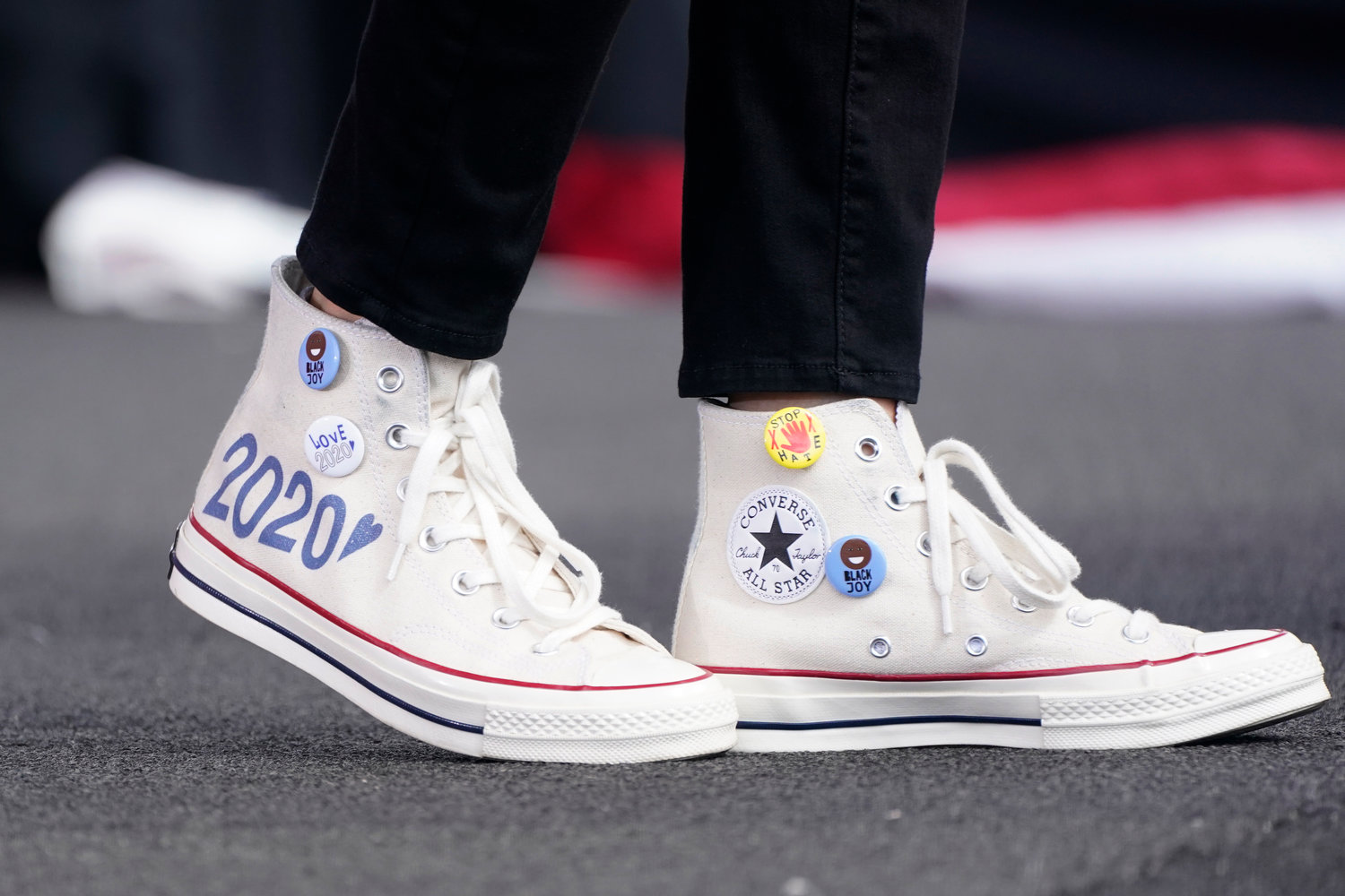 The sneakers of Democratic vice presidential candidate Sen. Kamala Harris, D-Calif., are shown as she speaks at a drive-in early voting event, Saturday, Oct. 31, 2020, in Miami, Fla. (AP Photo/Wilfredo Lee)