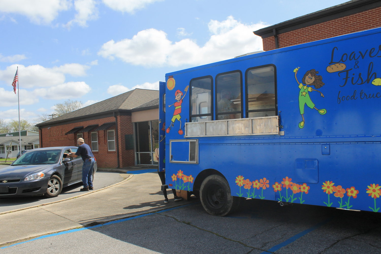 The Hope House Church Loaves & Fish food truck serves meals each Wednesday at the Jasper Housing Authority.