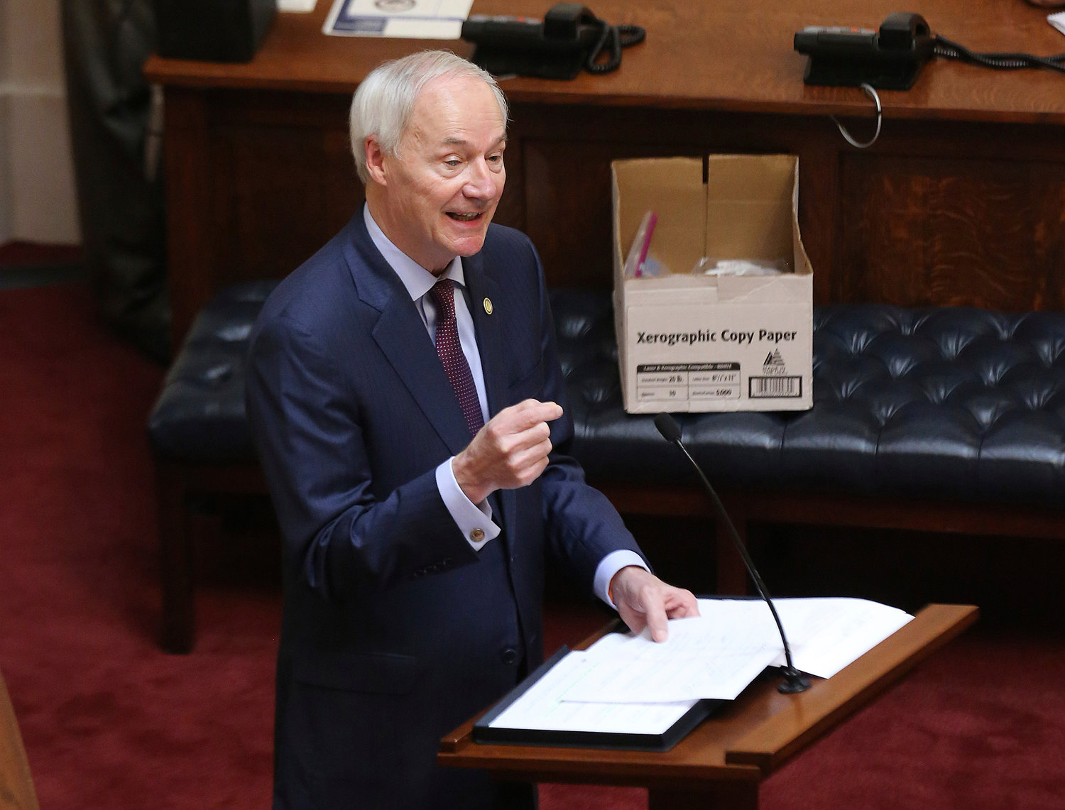 FILE - In this April 8, 2020 photo, Arkansas Gov. Asa Hutchinson gives the State of the State in the senate chamber of the state Capitol in Little Rock, Ark. Hutchinson vetoed legislation that would have made his state the first to ban gender confirming treatments for transgender youth. (Tommy Metthe/Arkansas Democrat-Gazette via AP, File)