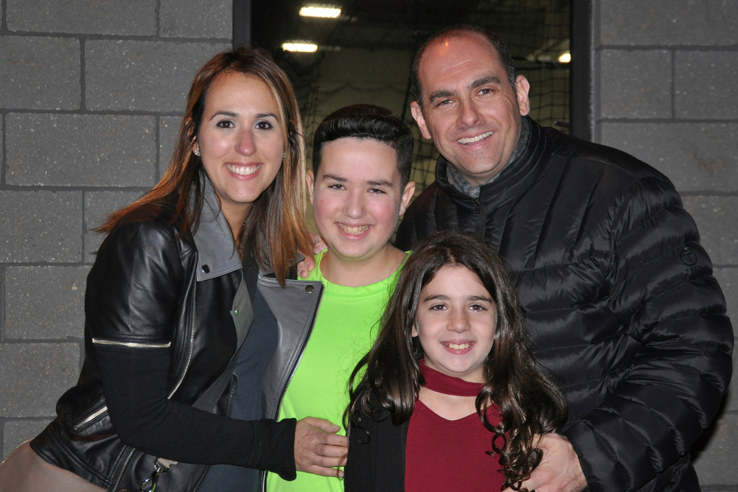 "This 2016 photo provided by the family shows Jake Kestler, center, with his parents and sister, a month before he was diagnosed with brain cancer. Jake received a genetically-modified virus-based treatment in October 2017 when he was 12. ""He lived for a year and four months after that,"" long enough to celebrate his bar mitzvah, go with his family to Hawaii and see a brother be born, said his father, Josh Kestler, of Livingston, N.J. (Family Photo via AP)"
