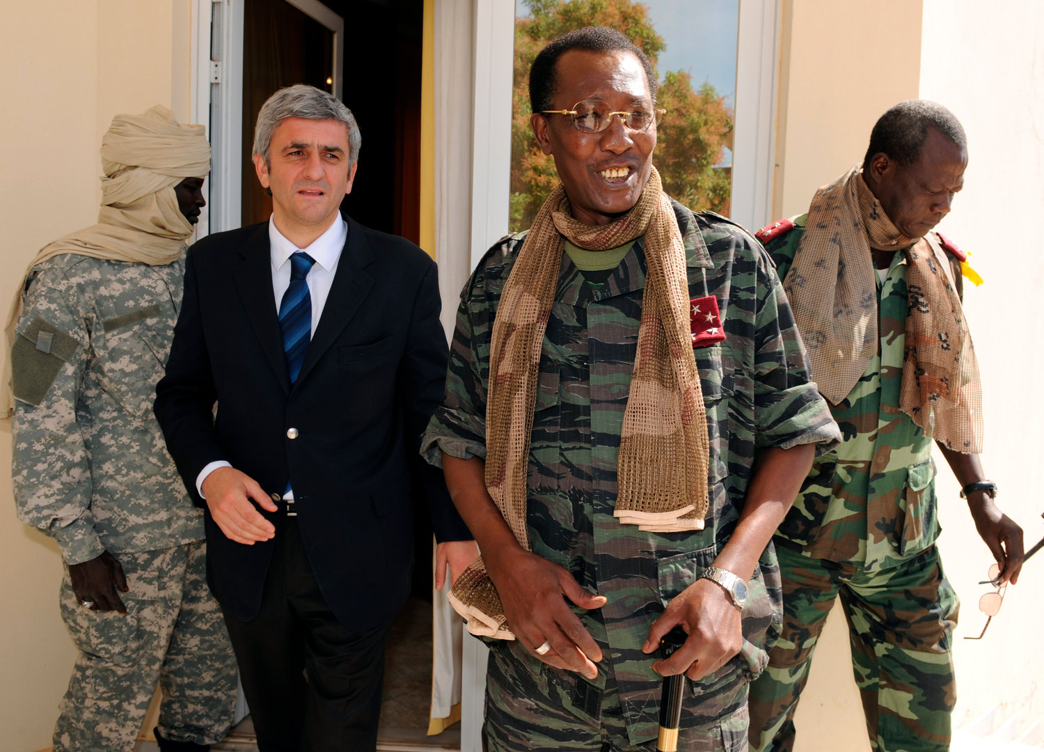 FILE - In this Wednesday, Feb. 6, 2008 file photo, Chad's President Idriss Deby Itno, center-right, meets with French Defense Minister Herve Morin, center-left, in N'Djamena, Chad. Deby, who ruled the central African nation for more than three decades, was killed on the battlefield Tuesday, April 20, 2021 in a fight against rebels, the country's top military commander announced on national television and radio. (Pascal Guyot/Pool Photo via AP, File)