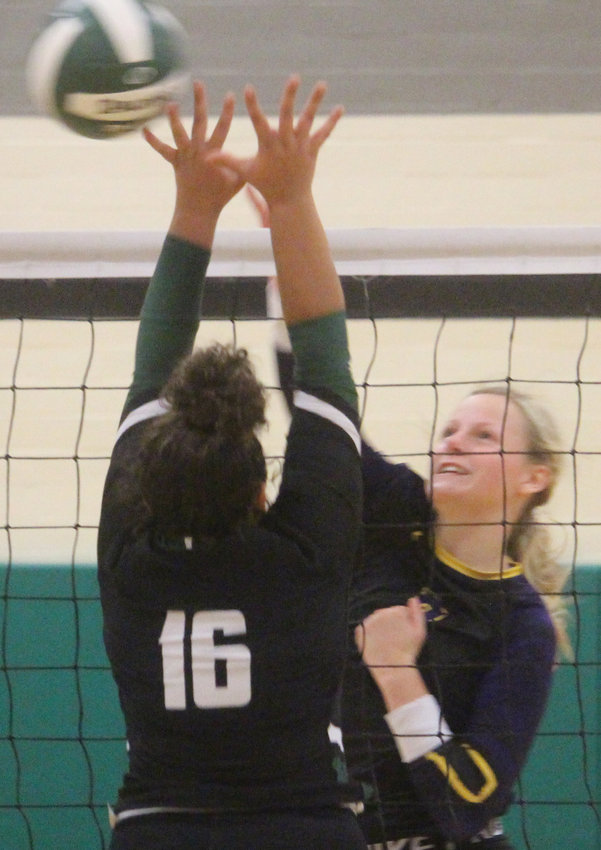 Logan-Magnolia's Courtney Ohl slams the ball past her defender at the Sept. 12 Spartan Invitational in Onawa.