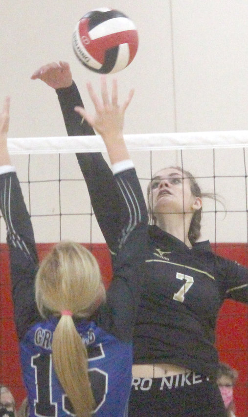 Woodbine's Whitney Kuhlman (7) knocks the ball past the Griswold defender at the Sept. 5 Missouri Valley Invitational.