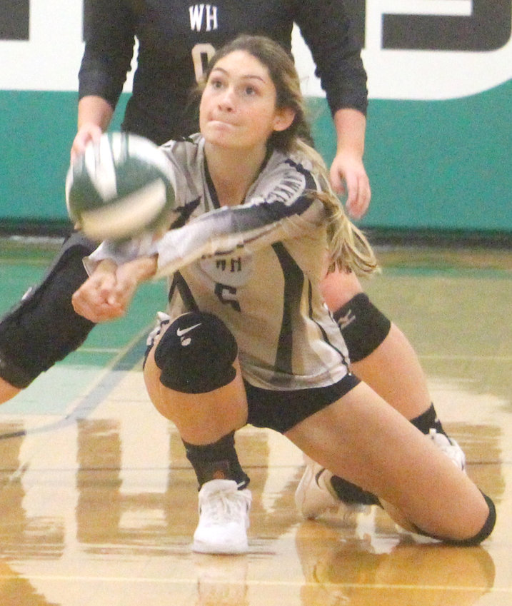 West Harrison's Kayla Lynch digs the ball off the net at the Spartan Invitational on Sept. 12 in Onawa.