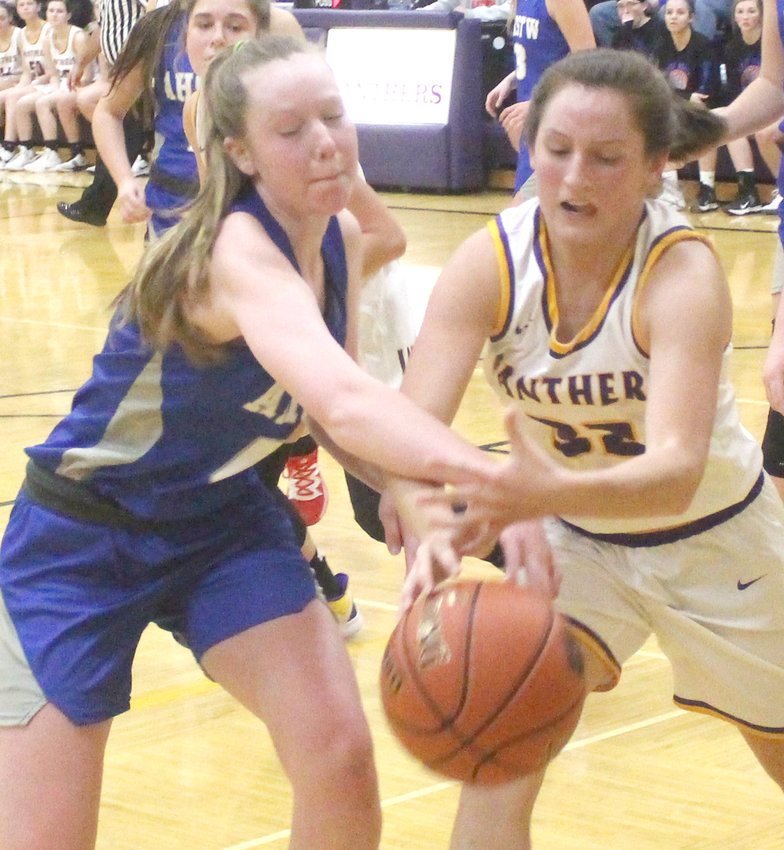 Logan-Magnolia's Emme Lake (32) battles for the rebound in Thursday's Western Iowa Conference with AHSTW. The Panthers will return to the court after the holiday when they travel to Audubon on Jan. 3, 2020, and host IKM-Manning on Jan. 7 when play resumes after the break.