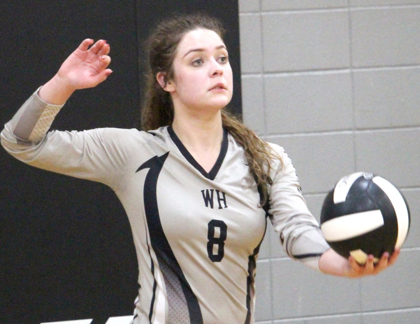 West Harrison's Maren Evans (8) serves the ball into play during recent Rolling Valley Conference play. The Hawkeyes will host Exira/EHK on Thursday.