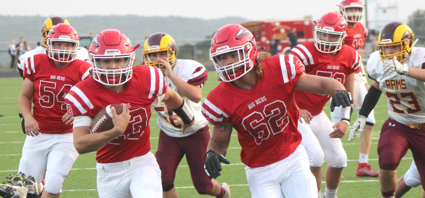 Missouri Valley's Eric McIlnay (23) carries the ball across the goal line for the Big Reds first touchdown in the Homecoming win over MVAOCOU on Sept. 18 in Missouri Valley. Big Reds lineman Jacob Meade (54) and Jace Coenen (62) cleared the path for the score.