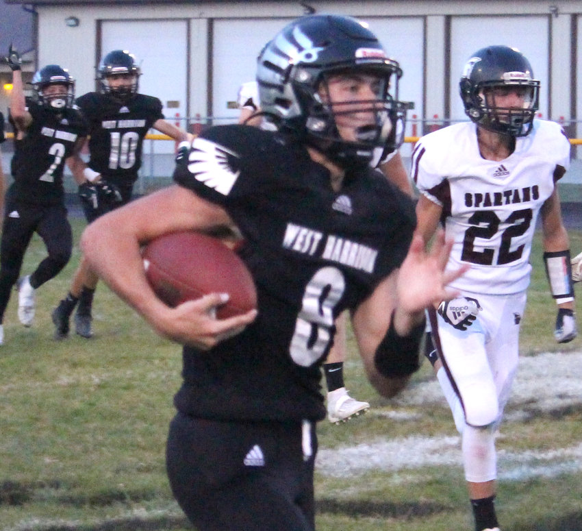 West Harrison's Grant Gilgen (8) finisehd with five russhing touchdowns and threw for another score in the Hawkeyes Homecoming victory over Exira/Elk Horn-Kimballton. West Harrison will be at Boyer Valley this week.
