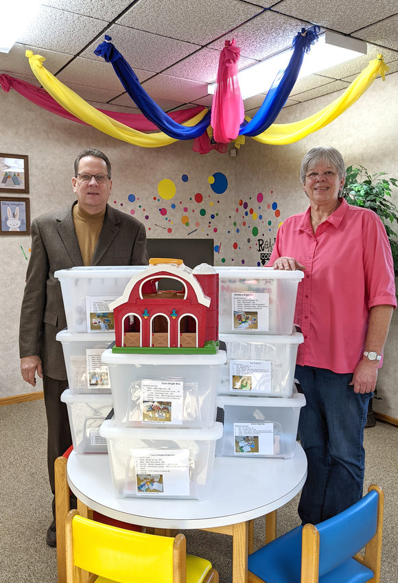The library received $500 from the IMT Community Contest to purchase items for the Bright Boxes. Pictured is Mark Boehm from McClintock-Boehm Insurance with Library Director Peg Gay.