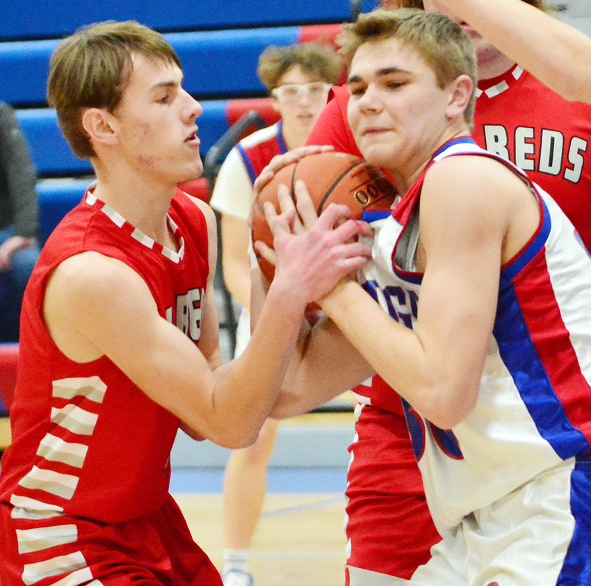 Missouri Valley's Will Gutzmer ties up the AHSTW offensive player in the Jan. 29 Western Iowa Conference battle against AHSTW in Avoca.