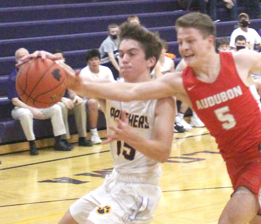Logan-Magnolia's Carter Edney (15) looks to control the ball in Western Iowa Conference play on Jan. 29 in Audubon.