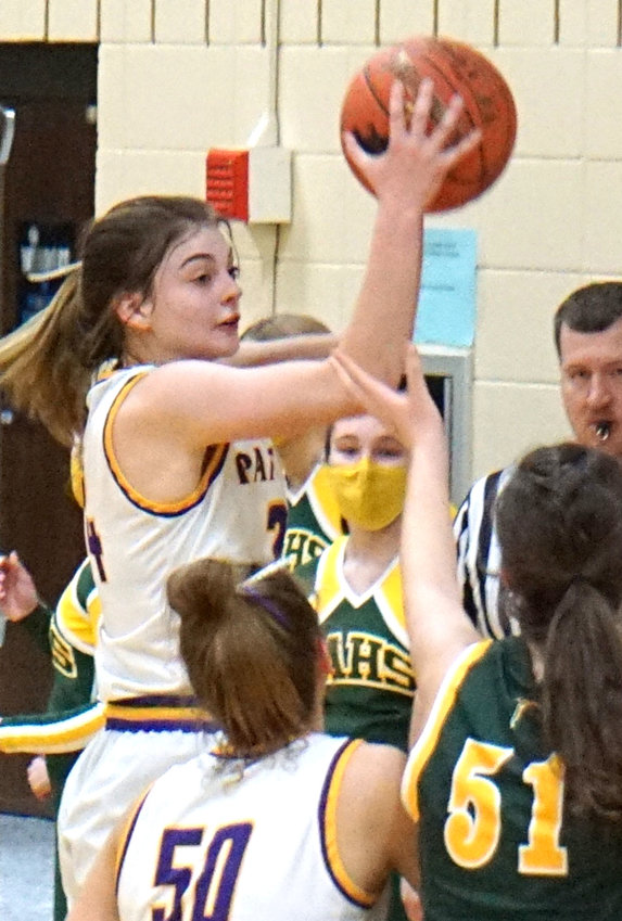 Logan-Magnolia's Emilie Thompson pulls down a rebound in the Class 1A Regional Semifinal game on Feb. 19 in Logan.