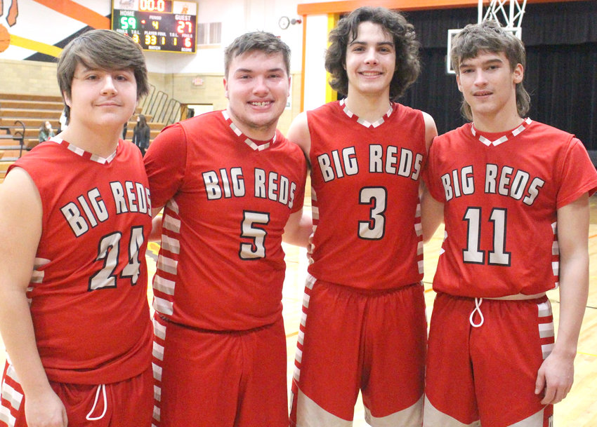 The Big Reds boys basketball season came to an end in the first round of the Class 2A Boys District Tournament on Feb. 15 in Holstein.  The four Big Reds seniors include, from left, Tony Sargent, Jacob Meade, Alec Fichter, Alex Murray.