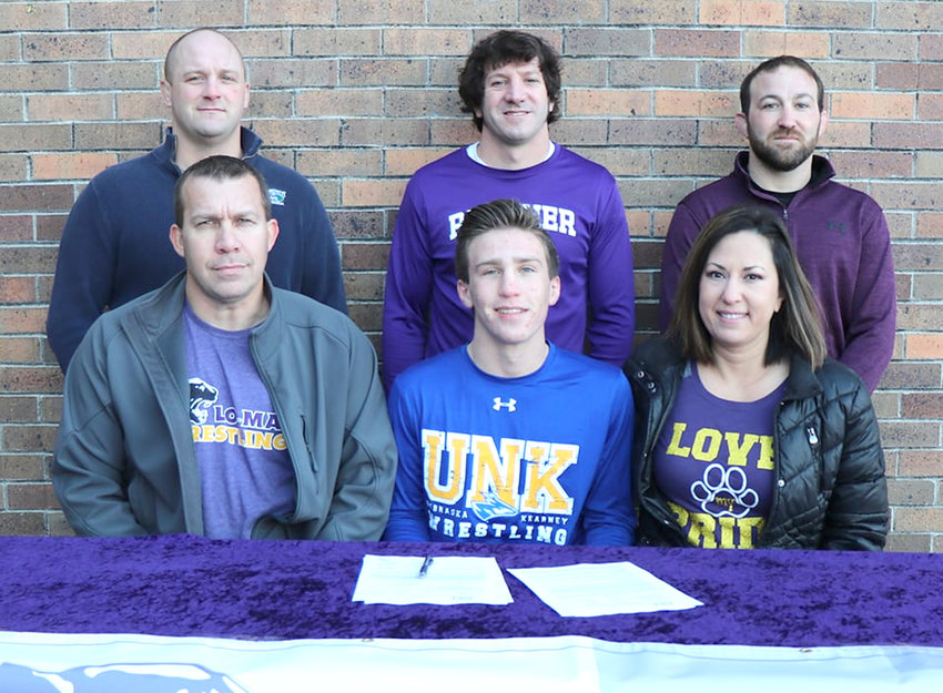 Logan-Magnolia's Briar Reisz (front, center) made his post-high school plans official on Jan. 26 when he signed his letter of intent to continue wrestling at the University of Nebraska-Kearney.  He is shown in the front row (from lef) with his parents Doug and Indria Reisz.  Standing in back include, from left, Coach Jeff Kuhl, Coach Dan Thompson, and Laramie Shaffer.