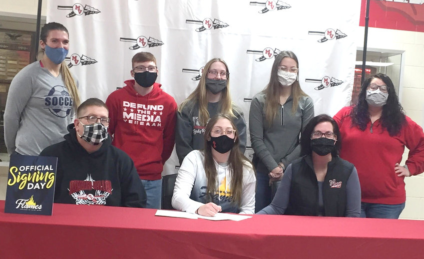 MV Senior Carlie Winchester (front, center) signed her letter of intent on Feb. 25 to continue playing soccer at the College of St. Marys in Omaha, Neb.  She is seated with her paretns, Brett (left) and Danielle (right) Winchester.  Standing in back include, from left, College of St. Marys Coach Jordan Irsik, Tye Knudsen, Shelby Winchester, Megan Winchester, MV Lady Reds Soccer Coach, Lacy West.