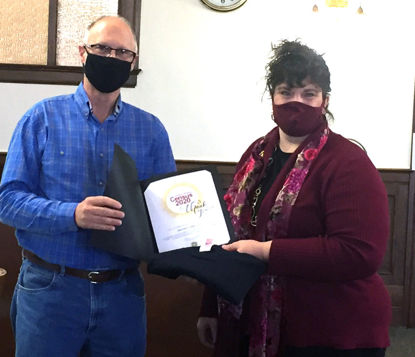 Harrison County Chairman of the Board of Supervisors presented Harrison County Development Corporation Director Renea Anderson with a certificate at the March 18 regular board meeting for her Census 2020 efforts.