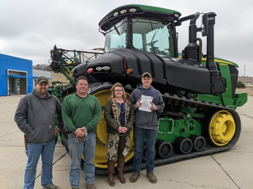 """Van Wall Equipment in Denison is excited to provide Nathan Gorden a sponsorship and tuition and tool assistance to attend Southeast Community College located in Milford, Neb., while he completes his John Deere Ag Tech degree. Location Manager Ryan Morgan said, """"We are excited to have Nathan on our Van Wall team as an Ag Technician!"""".Pictured, from left, are Morgan, Joe Gorden, Holly Gorden, and Nathan Gorden."""