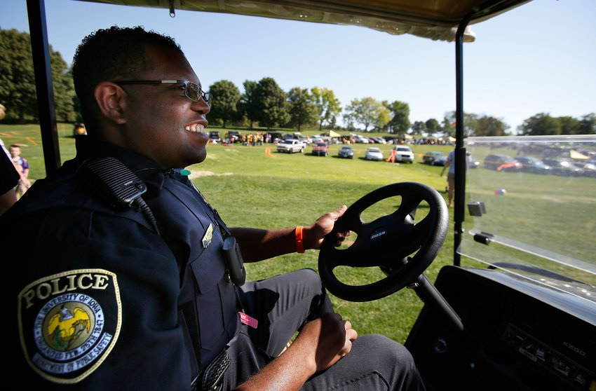 University of Iowa Police Officer Alton Poole wears his VIEVU LE2 Body Worn Video Camera as he patrols the Finkbine Golf Course tailgating lot before Iowa's game against Northern Iowa Saturday, Sept. 15, 2012 in Iowa City. The University of Iowa has outfitted all 43 of their police officers and 18 members of their security staff with the cameras at a cost of $899 each. (Brian Ray/The Gazette-KCRG)