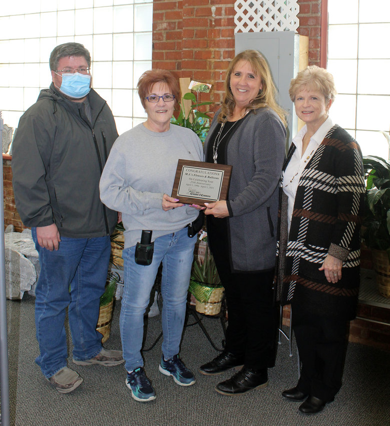 Mary Jo Buckley, second from left, received a plaque commemorating 25 years of business in Missouri Valley. Presenting MJ with the plaque is the Missouri Valley Chamber of Commerce representatives Clint Sargent, left, Judy Holcombe, and Chamber Director Jeannie Wortman.