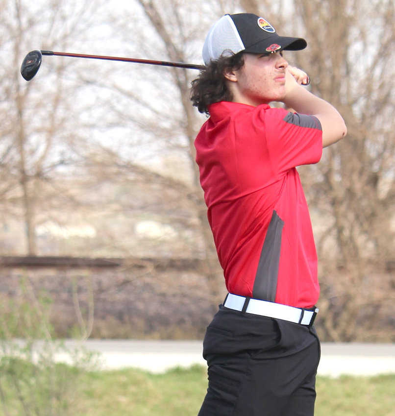 Missouri Valley's Alec Fichter watches the ball sail down the fairway during Western Iowa Conference play on April 6 vs. AHSTW.