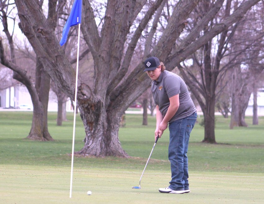 Trace Schroeder watches his putt on April 9 during a triangular on April 9 at Willow Vale Golf Course in Mapleton.