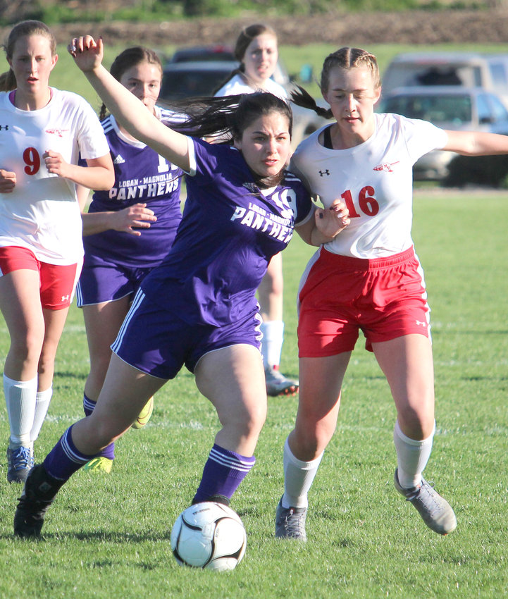 Logan-Magnolia's Jesenia Gonzales (19) and Missouri Valley's Sophie Caniglia (16) battle for position in Western Iowa Conference soccer action in Logan on April 12.