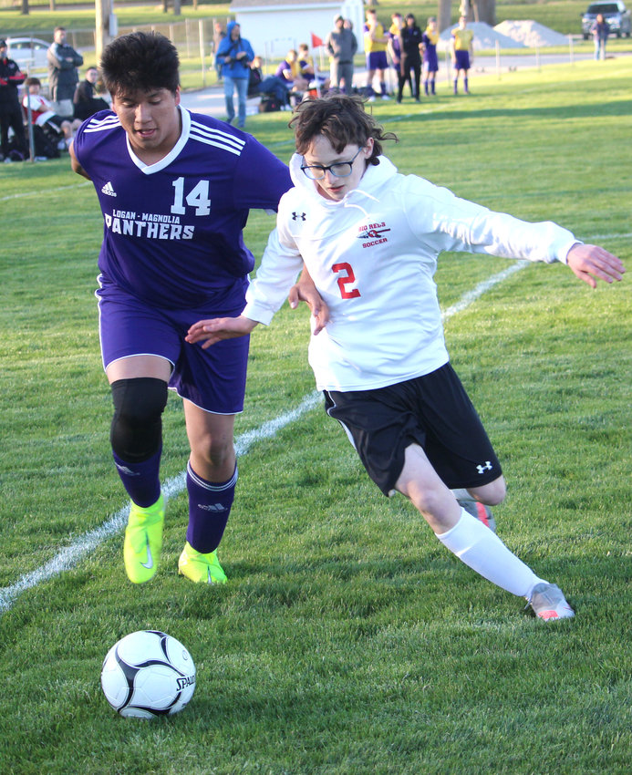 Logan-Magnolia's Nicio Adame (14) and Missouri Valley's Parker Ferris (2) battle for position during Western Iowa Conference soccer action on April 12 in Logan.