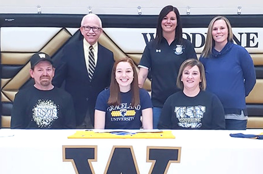 Woodbine senior Alexa Steinkuehler (front, center) signed her letter of intent on March 14 to continue playing college volleyball at Graceland University (Lamoni) starting in the fall of 2021.  She was a three-year member of the Rolling Valley All-Conference team, including first team as a senior.  The Tigers front row standout finished her senior campaign iwth 139 kills, 50 blocks (30 solos), while adding 151 digs.  She was a successful 193-222 (86.9 pct.) behind the service line, while adding 44 ace serves.  She is seated in the front row with her parents, Shane (left) and Kelli Steinkuehler.  Standing in back include Graceland University Coach Stew McDole, and Woodbine High School co-coaches Beth Peterson and Ann Fouts.