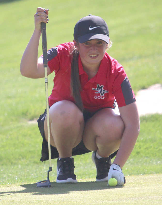 Missouri Valley's Maddie Hansen lines up her putt attempt during Western Iowa Conference play on April 26 against Treynor.