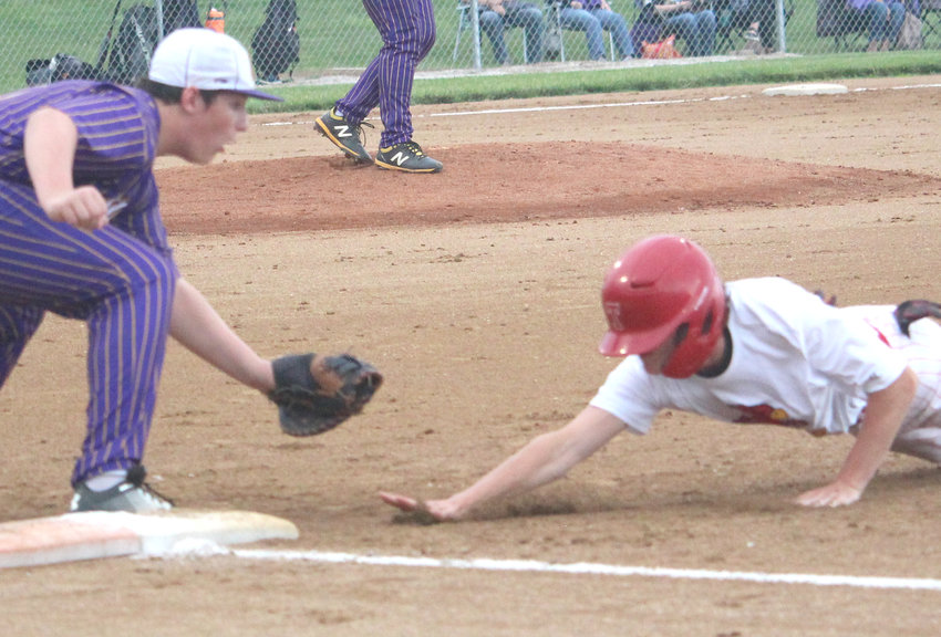 Logan-Magnolia's Ryder Harkelroad slaps the tag on the Treynor baserunner in Western Iowa Conference actionon June 11 in Logna.