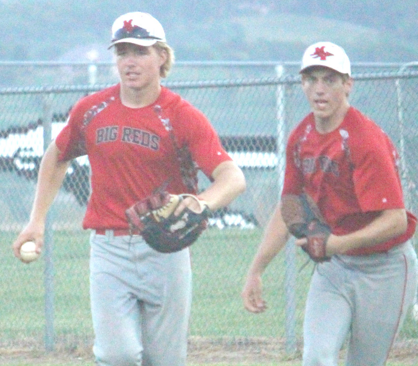 Missouri Valley's Gage Clausen (left0 and Ryan Russman celebrate after finishing off a double-play in last week's Western Iowa Conference battle iagainst Riverside.