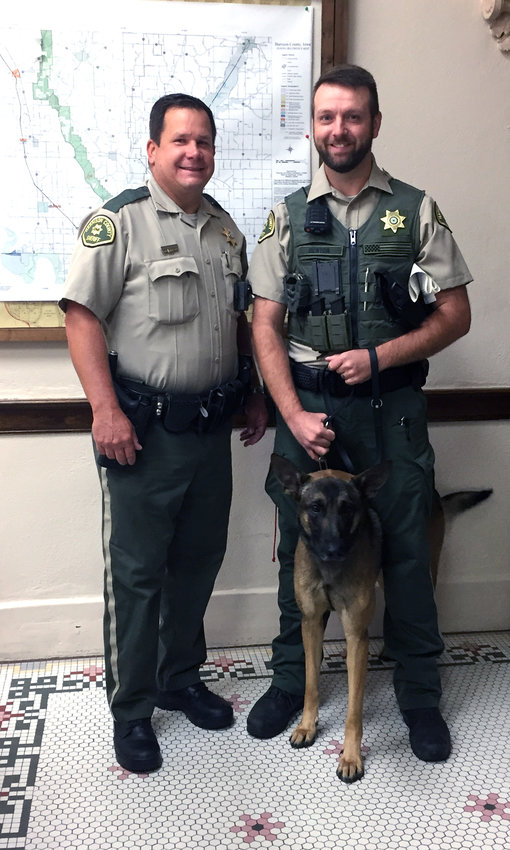 Sheriff Brandon Doiel, left, introduced the newest member of the Sheriff's Office, K9 Leo, who stands with handler Deputy Todd Denton, to the Harrison County Board of Supervisors on Thursday, Sept. 9.