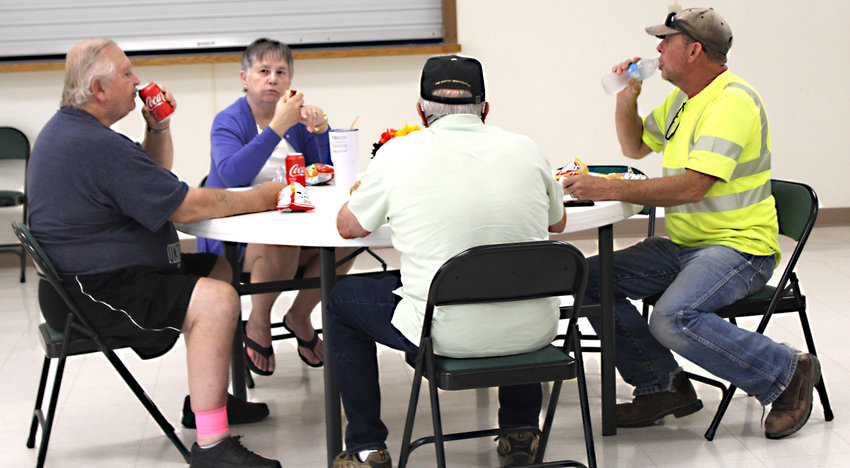 """Dozens of citizens enjoyed lunch at the Rand Center during the 2019 Missouri Valley Chamber of Commerce Appreciation BBQ. While many stopped in for a meal with friends and co-workers, like these folks, others ordered their burgers, hot dogs, chips and drinks to go in advance. More than 300 lunches were given, according to Chamber Director Jeannie Wortman, who said, """"It was a terrific turnout from the community."""".The annual barbecue was offered last year, but due to the pandemic, there was no dine-in option."""