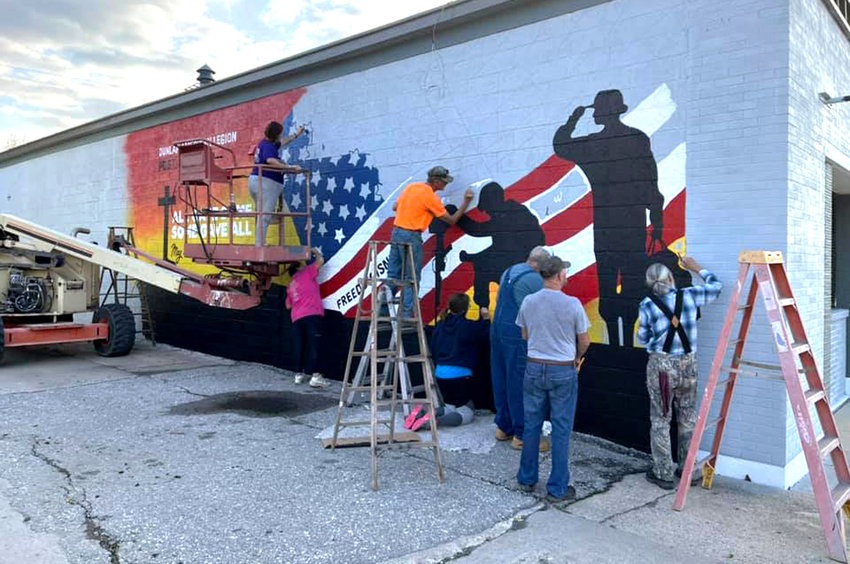 Dunlap's newest mural is up. This work, the sixth in the community, was a collaboration with the local American Legion, and veterans were on hand each evening with other volunteers.