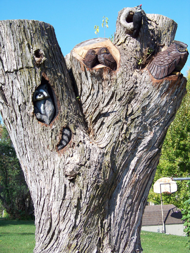 An unnamed chainsaw artist carved a tree that had been cut down recently. The art can be seen at 405 S. 11th St. in Dunlap.
