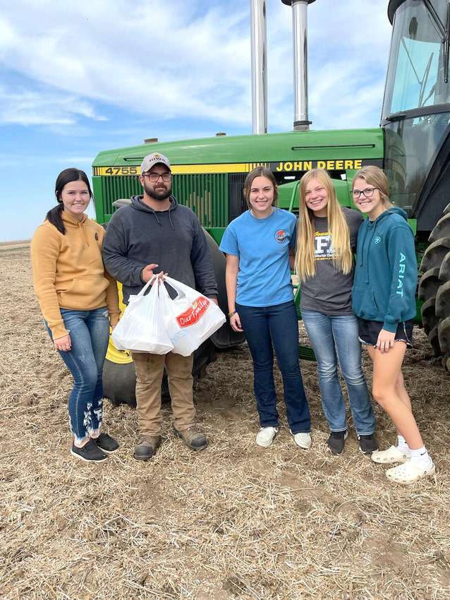 FFA members Jersey Divis, Leah Parker, Sara Rosener, and Tawnie Cass deliver a meals to an area farmer.