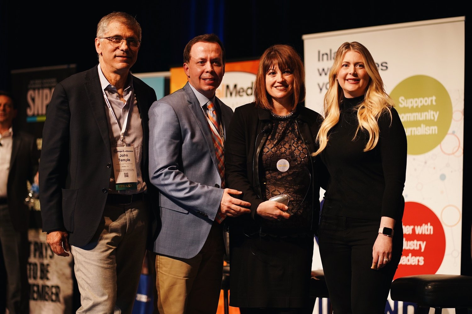 Pictured left to right: John Temple (one of the Mega-Innovation Award judges), and Jason Taylor, Rebecca Capparelli and Lyndsi Lane of GateHouse Live.